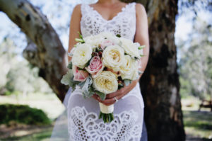 Bride holding a lovely bouquet of flowers