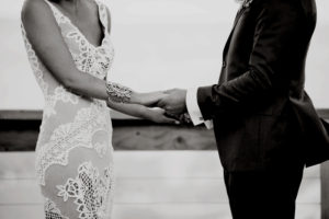 Holding hands during the wedding ceremony