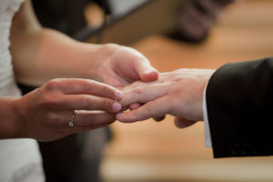 Exchanging rings during the marriage ceremony
